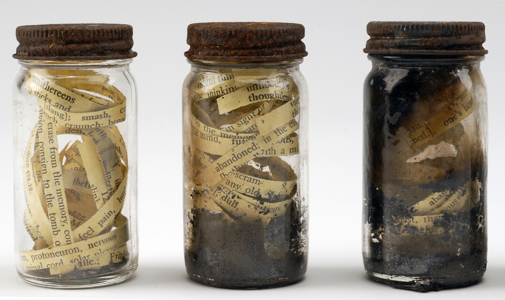 Anthony combs the ashes in search of his memory: Fourteen jars