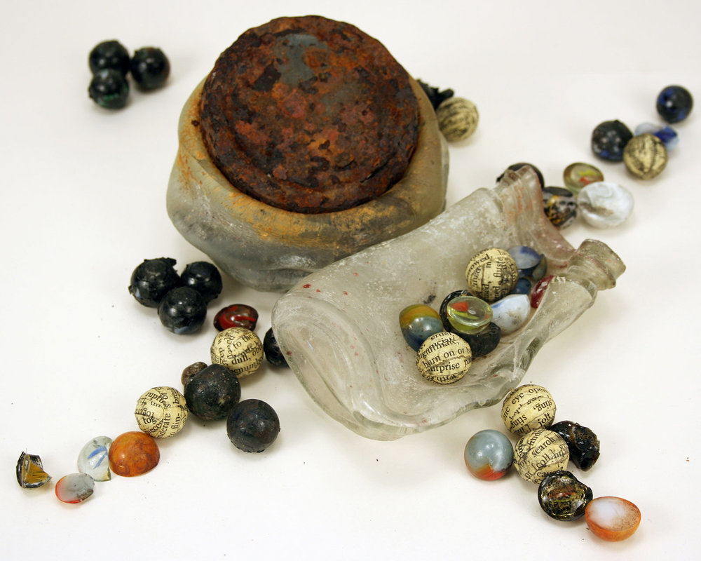 Anthony recovers lost marbles: Two jars and marble fragments