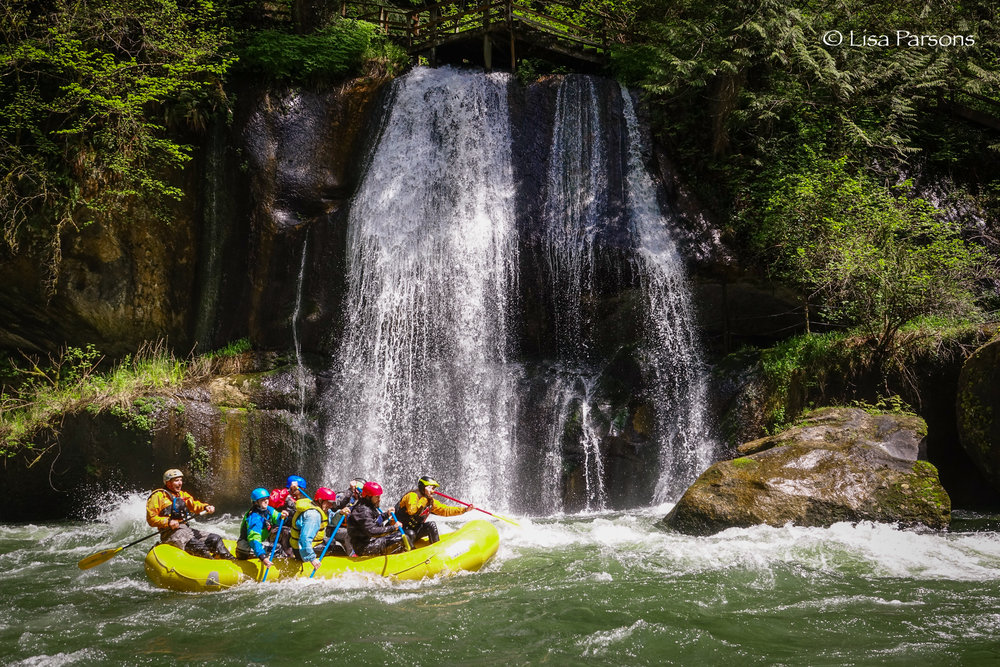 Whitewater rafters enjoying the Gorge at Paradise Falls at the Green River Gorge Resort.