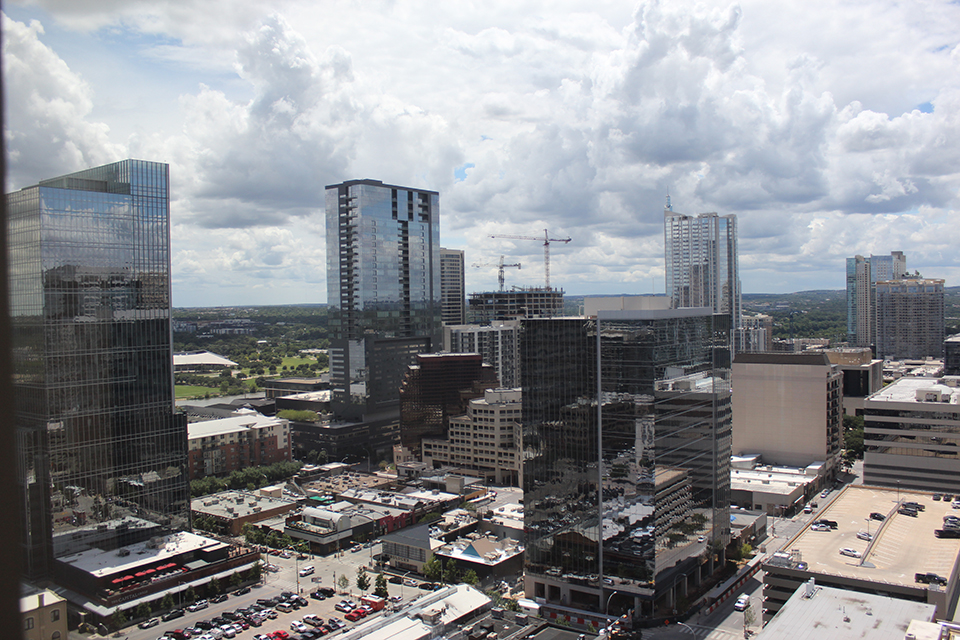 Our Location:  We are right in the heart of downtown Austin at 6th and Congress. This is our 21st-floor view westward from one of our offices.