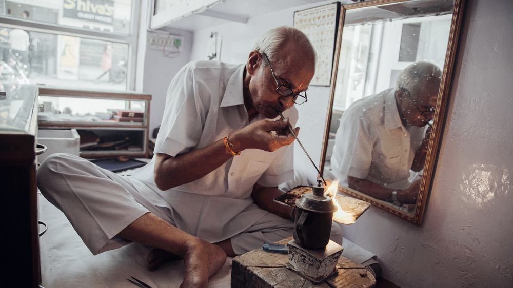 Master jeweller R.S Doni uses a blowpipe to set our logo in copper.