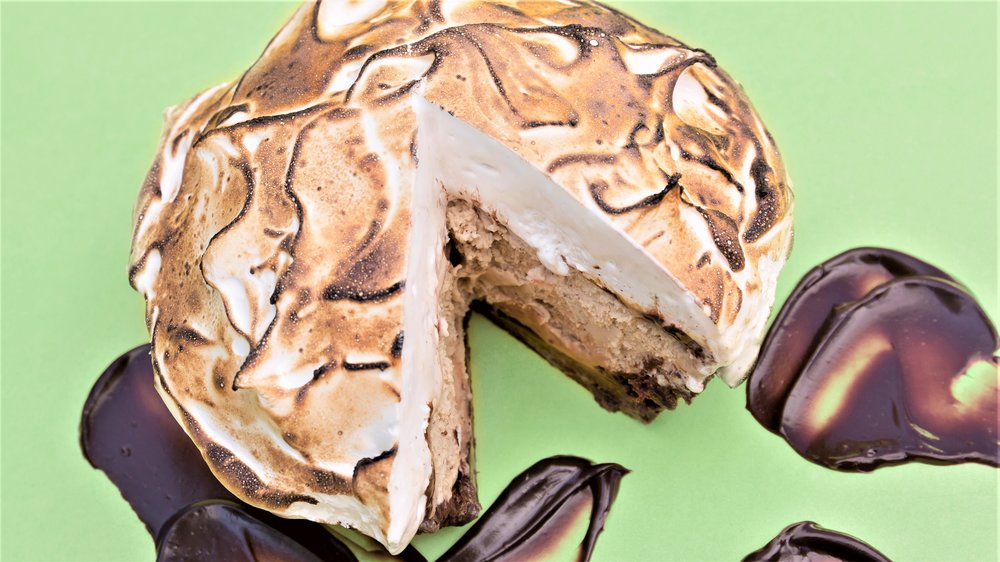 Our gelato pies are made with brownie crumb crust, a layer of gelato, a layer of fudge sauce, and a layer of torched marshmallow meringue.