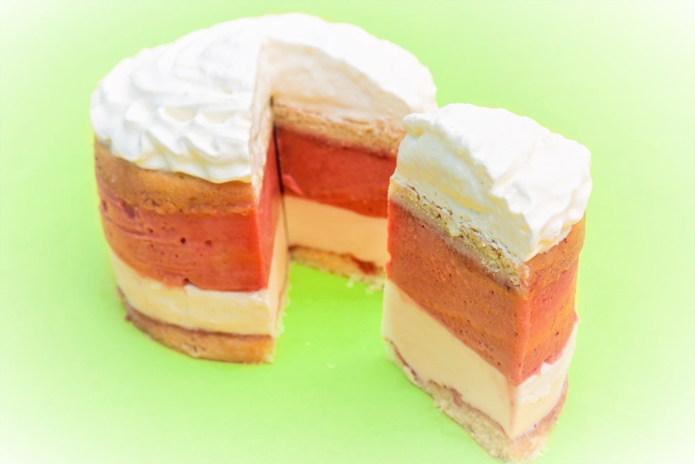 We also offer a rotating selection of seasonal gelato cakes. Our current selection is Strawberry Shortcake. This cake is made with yellow cake soaked in strawberry sauce, a layer of Tahitian Vanilla gelato, another layer of yellow cake soaked in strawberry sauce, a layer of Strawberry Sorbetto, and a layer of fresh whipped cream.
