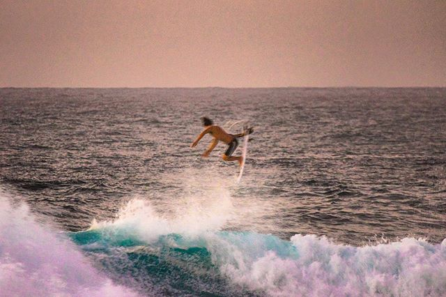 Flyby blur during North Shore golden hour.