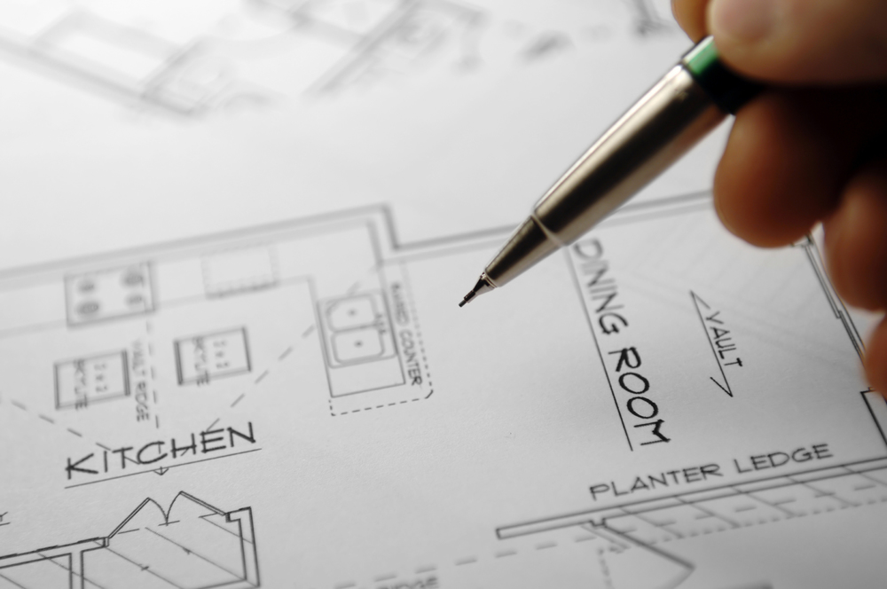 stock-photo-55709268-architectural-blueprints-and-blueprint-rolls-with-drawing-instruments.jpg