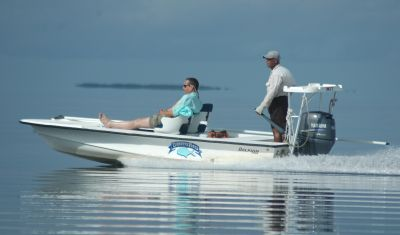 Fly Fishing boats and fishing guides with vacationer in Belize