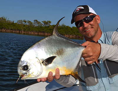 Fly Fishing for permit in Belize is enjoyed by this happy angler