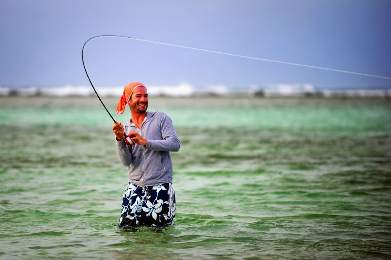 Another happy angler catch a big one while fly fishing for bonefish in Belize.  Steve Turner Photo