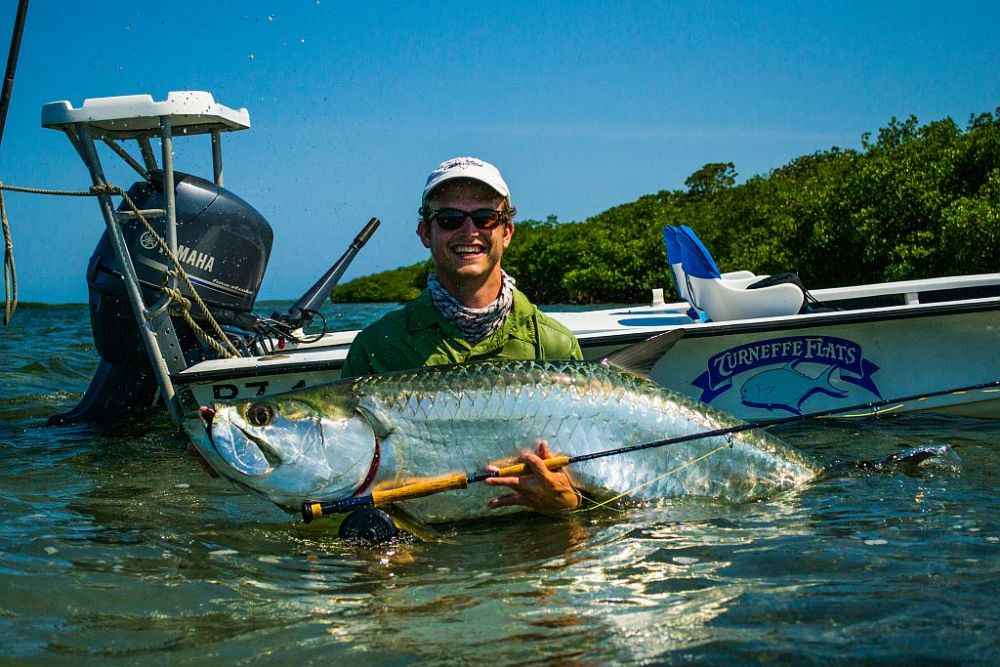 Fly Fishing for tarpon in Belize.  Success was found by this angler.