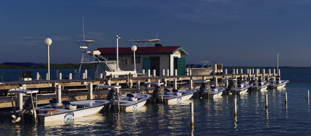 Belize permit fishing lodge, fishing skiffs.