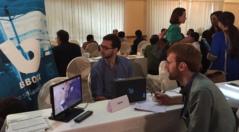 Representatives from BBOXX and SELCO Foundation meet at the 2015 Global LEAP Networking Event in Dhaka, Bangladesh.