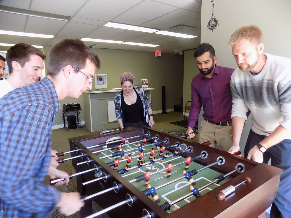 FreshWorks - Team playing foosball in office 2016.JPG