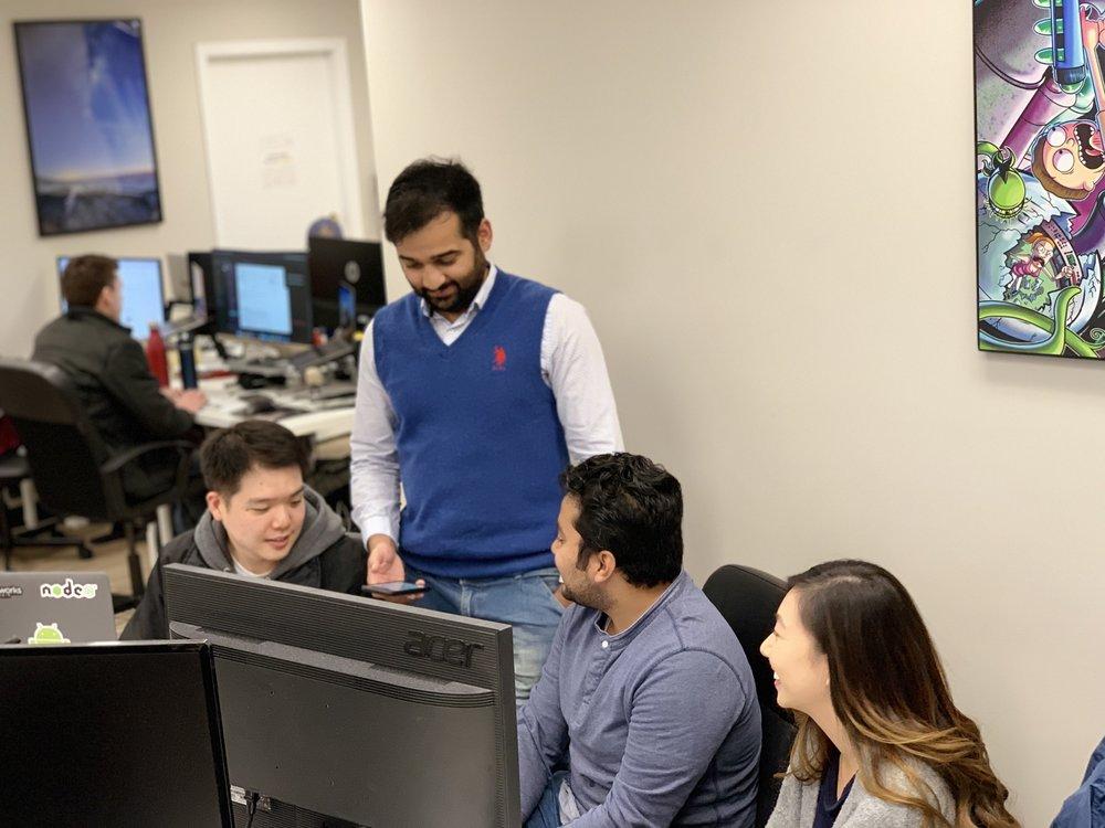 Gisu working with Sam, Tushar, and Judy on the BC Gov Directory App