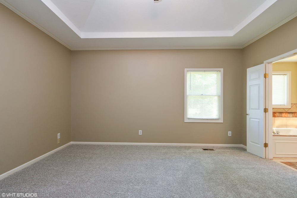 13_608SWTrailparkCircle_178_MasterBedroom_HiRes.jpg