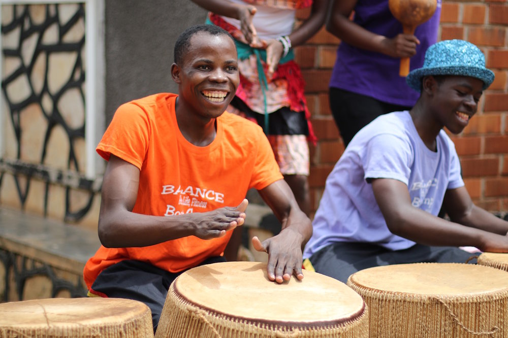 """Sebastian learned to play drums at Bitone. """"We have performed plays in communities to raise awareness of HIV/AIDS. The Center has given me strength and community,"""" he said. (Left in this photo: Sebastian)"""