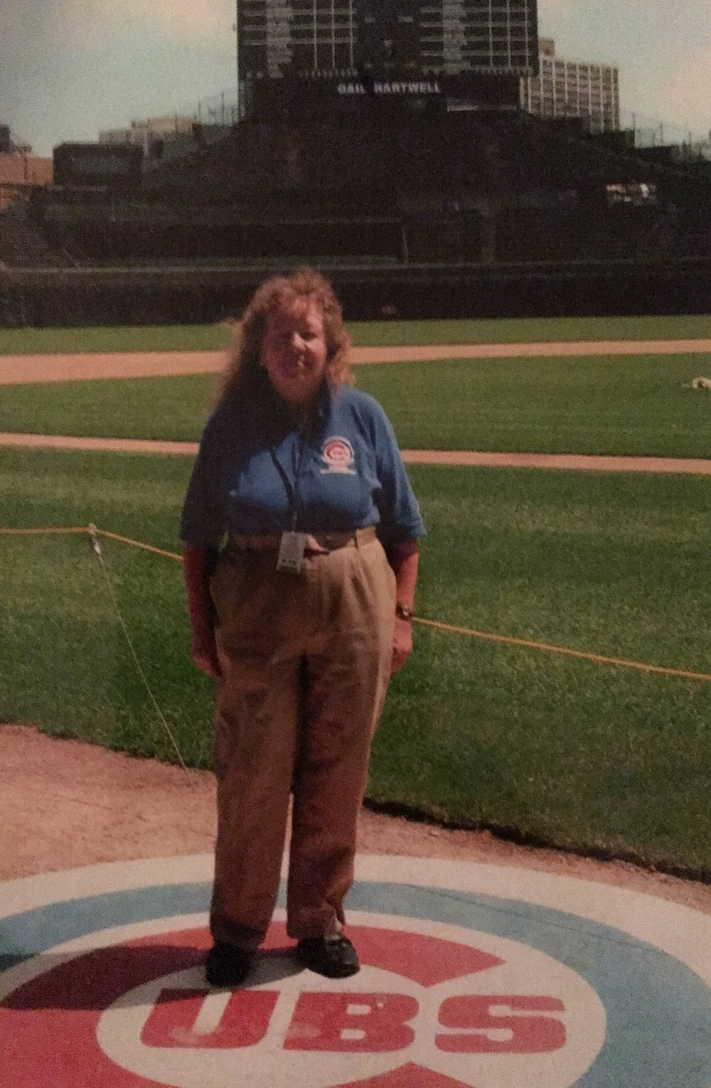 After retiring from a career in the school system, Grandma continued watching Cubs baseball everyday but from a little closer than her living room. Her Cubs staff photo from a couple years ago.