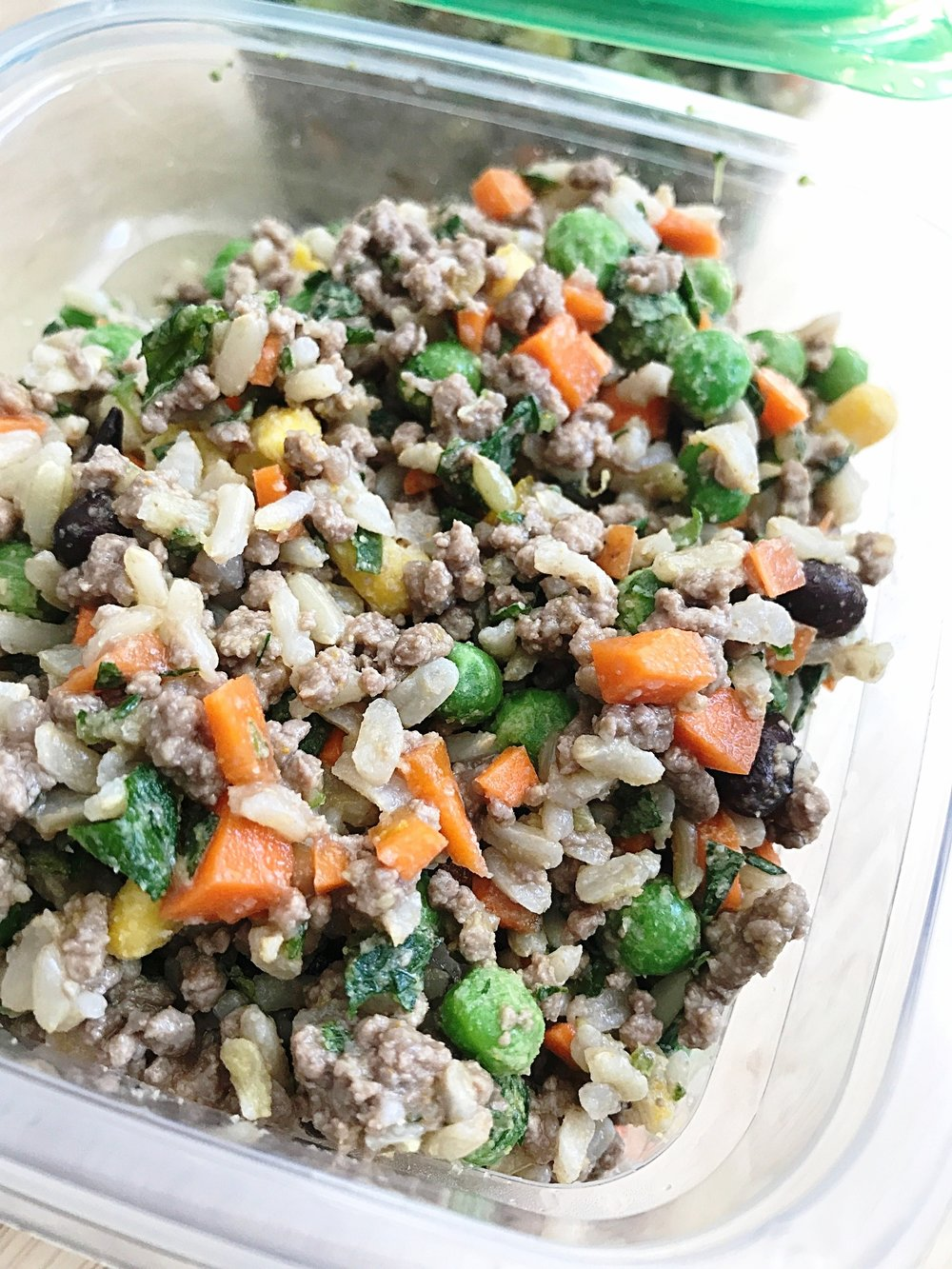 Ground beef, peas, carrots, parsley and brown rice.