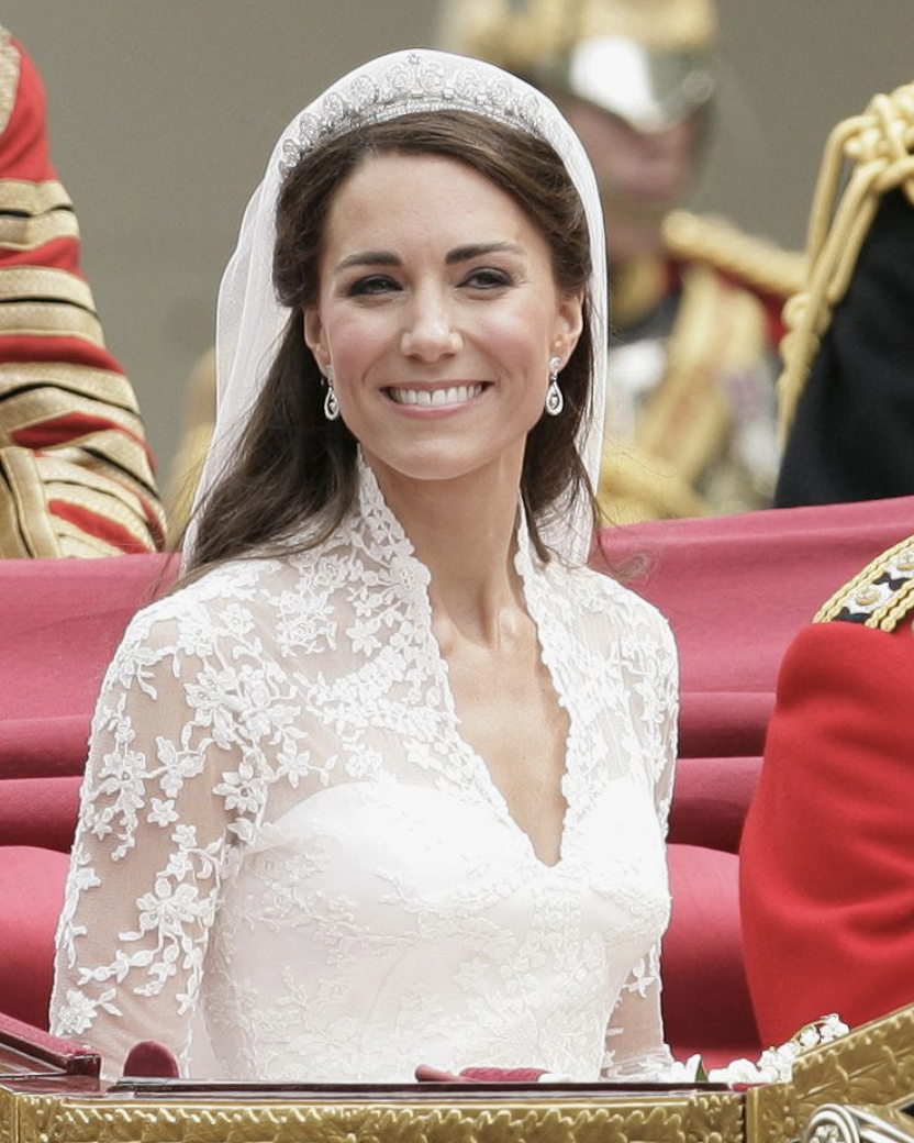 Cartier Halo Tiara - Kate wore the Cartier Halo Tiara (also called the Cartier Scroll Tiara) for her wedding to Prince William in 2011. It was loaned to the Duchess by Queen Elizabeth. The tiara was purchased from Cartier by Elizabeth's father, King George VI, for his wife, the Queen Mother, as an anniversary gift in 1936. The Queen Mother then gave it to Elizabeth on her 18th birthday.