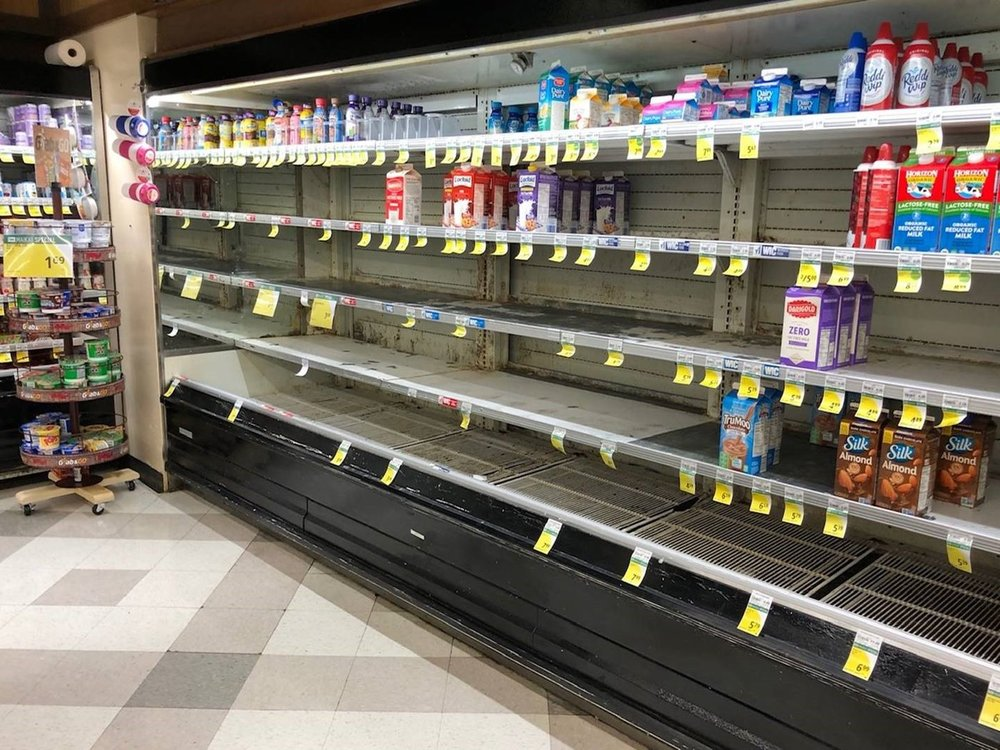 On Monday there was barely any milk left on the shelves of an Ewa Beach grocery store. (Image: Janus Mantaring)