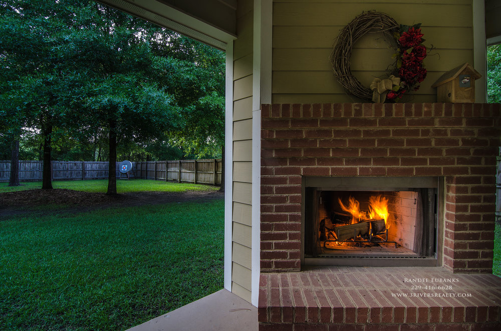 3riversrealty_bainbridge-georgia-home-for-sale_3-bed-2-bath_outdoor-fireplace_three-rivers-realty_mills-brock_TaurusUSA_pool_back-porch-fireplacae_afternoon1 - Copy.jpg