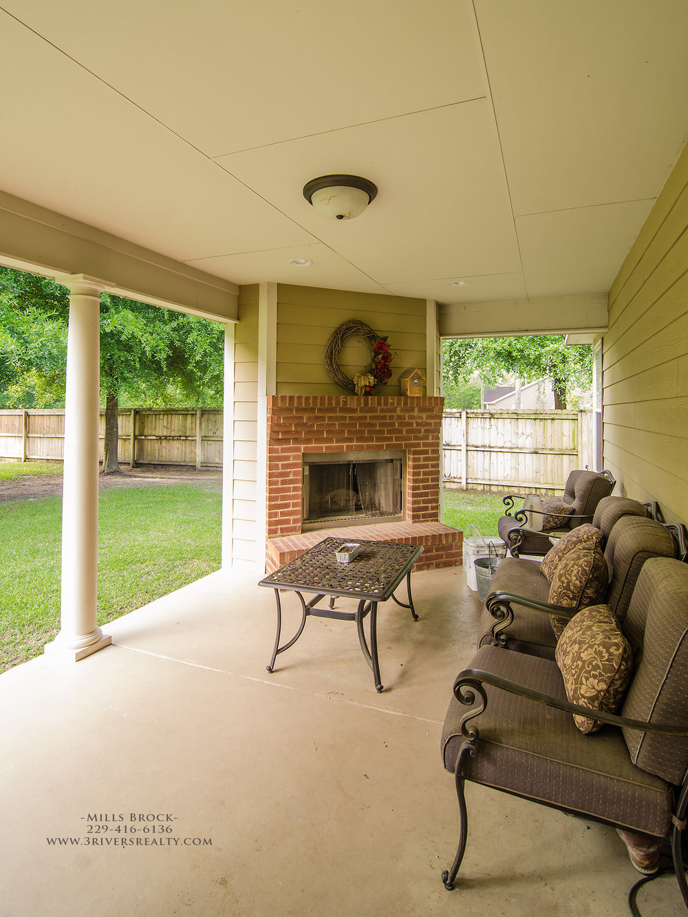 3riversrealty_bainbridge-georgia-home-for-sale_3-bed-2-bath_outdoor-fireplace_three-rivers-realty_mills-brock_Taurus-USA_-pool_back-porch-fireplace - Copy.jpg