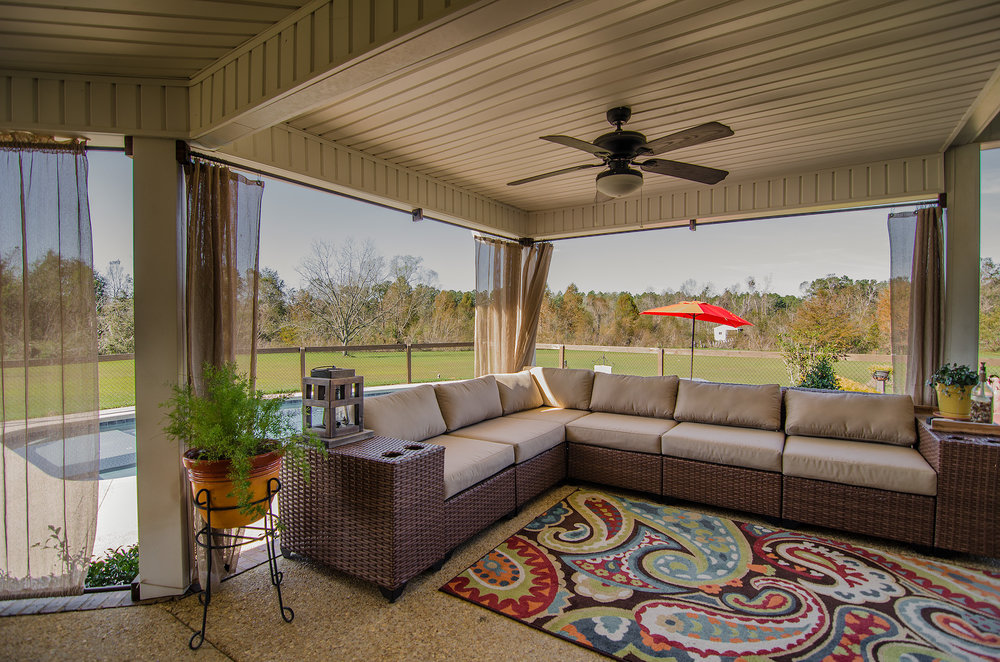 Outdoor Living - The huge back porch is accessible by multiple locations from the interior of the home. The back porch is more like another room to the home and functions more as a living room than just your average porch.