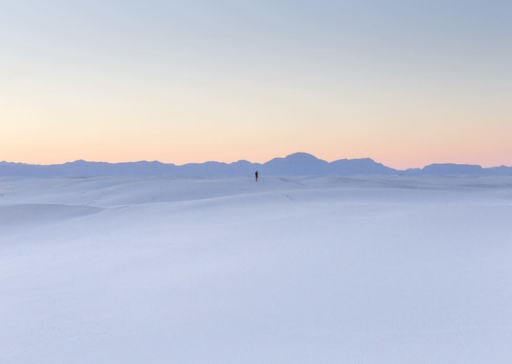 'A LONE FIGURE STANDS AT SUNSET. WHITE SANDS NEW MEXICO' BY PATRICK SAGGERS  @PATRICK.AIDAN