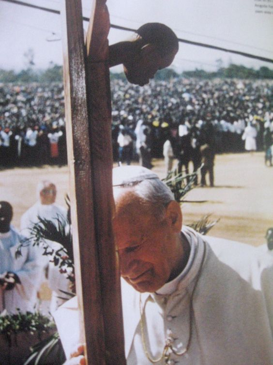 Pope John Paul II (St. John Paul the Great) praying before a black crucified Christ in Angola in the late 20th century. Pope John Paul II canonized St. Faustina on the Feast of Divine Mercy in 2000 and instituted the feast for the universal Church. The man himself died on the vigil of Divine Mercy Sunday in 2005. He was beatified by Pope Benedict XVI on the Feast of Divine Mercy in 2011 and was canonized on the same feast by Pope Francis in 2014.