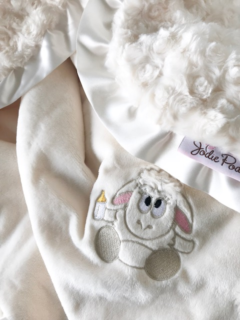 "lovies - the same ultra-luxurious fabrics are used to create the jodie podie ""lovies"" collection. the only difference is that your child's new, little animal friend is embroidered on the blanket.PROUDLY MADE IN CANADA"
