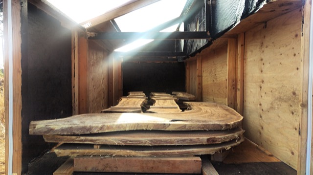 Wood stacked and drying in the kiln