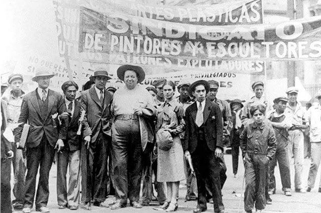 Frida Kahlo and Diego Rivera at a demonstration of the Syndicate of Technical Workers, Painters, and Sculptors, May 1, 1929