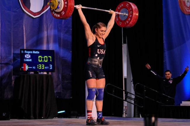 Mattie rogers, smiling, with 133kg over her head