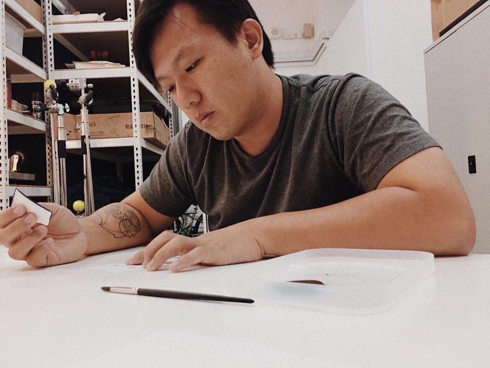 Kenneth_working on namecard_pixioo.jpg