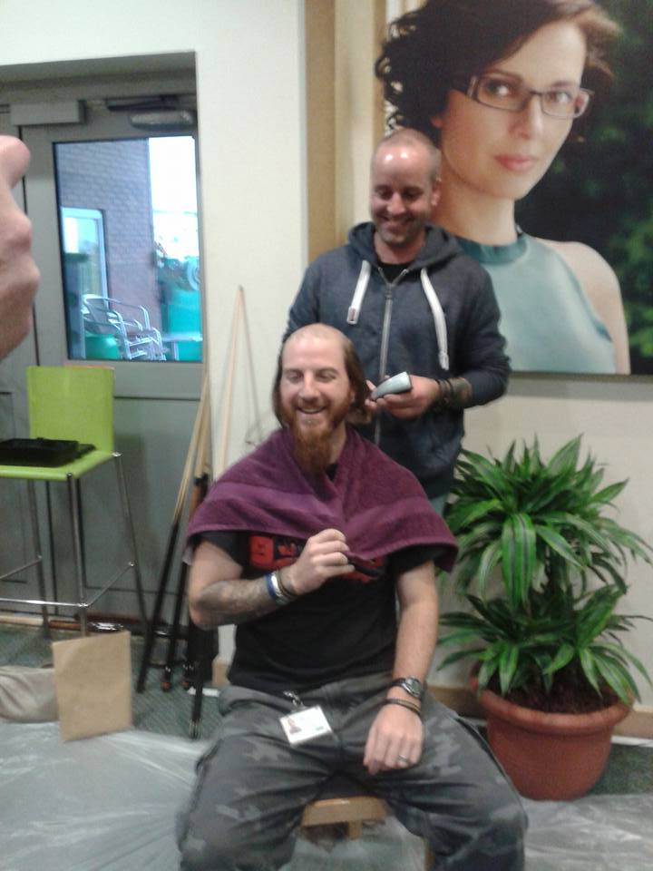 Our good friend Daz Carre having his lovely long hair shaved off (and a bit of his beard off) after reaching a set target of donations from his work colleagues @ Specsavers Gsy.  Over £850.00 was raised and Geoff had the privilege of chopping it off.  The pony tail was donated to the Little Princess Trust who provide real wigs for children who have lost their hair.  Daz also ran a 24hr Marathon for Jonah back in April 2015 and raised over £2,000.00 for the Rhys Daniels Trust who provided our accommodation in Bristol.