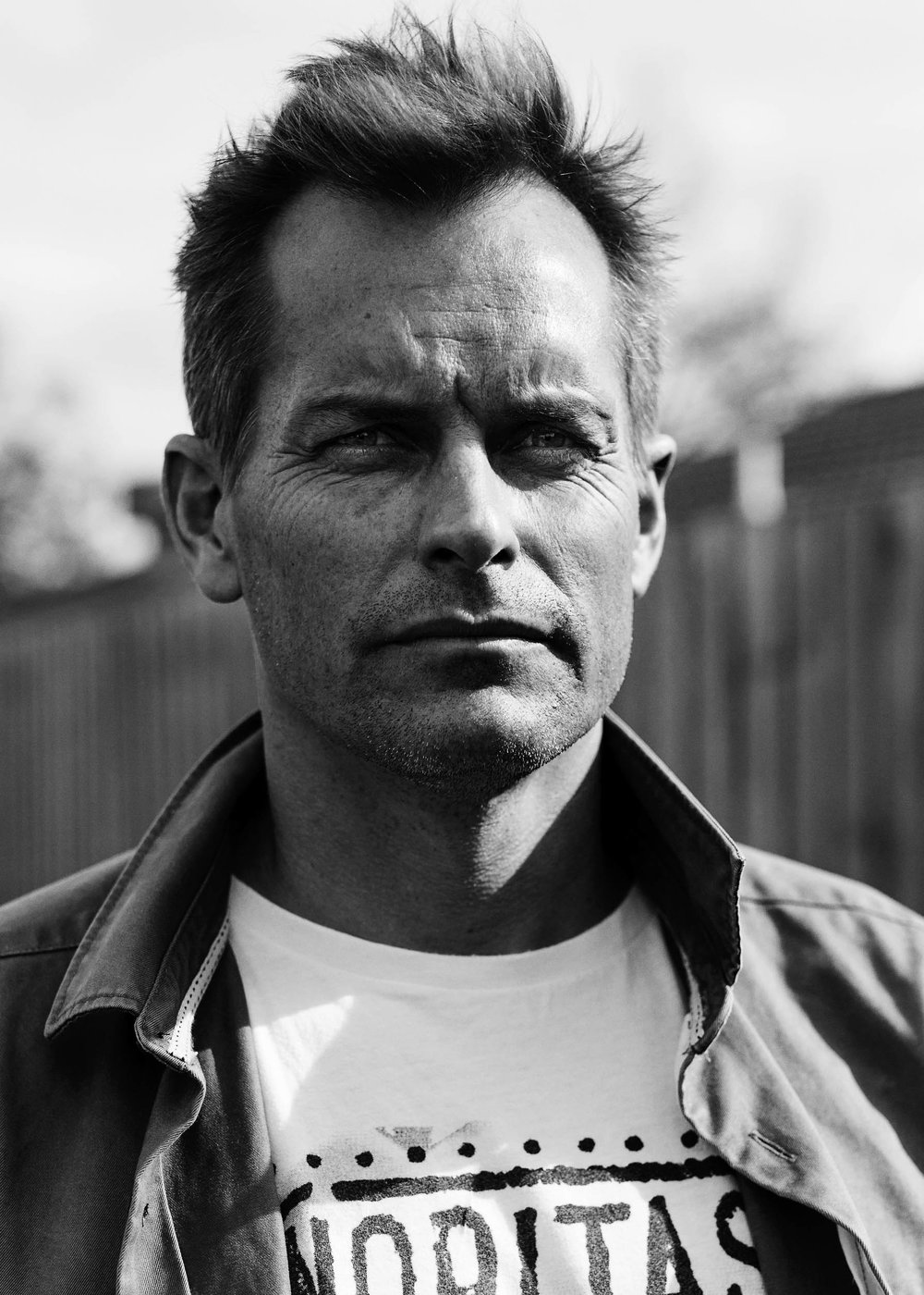 Black and White Headshot of James by photographer Nick Walters .jpg