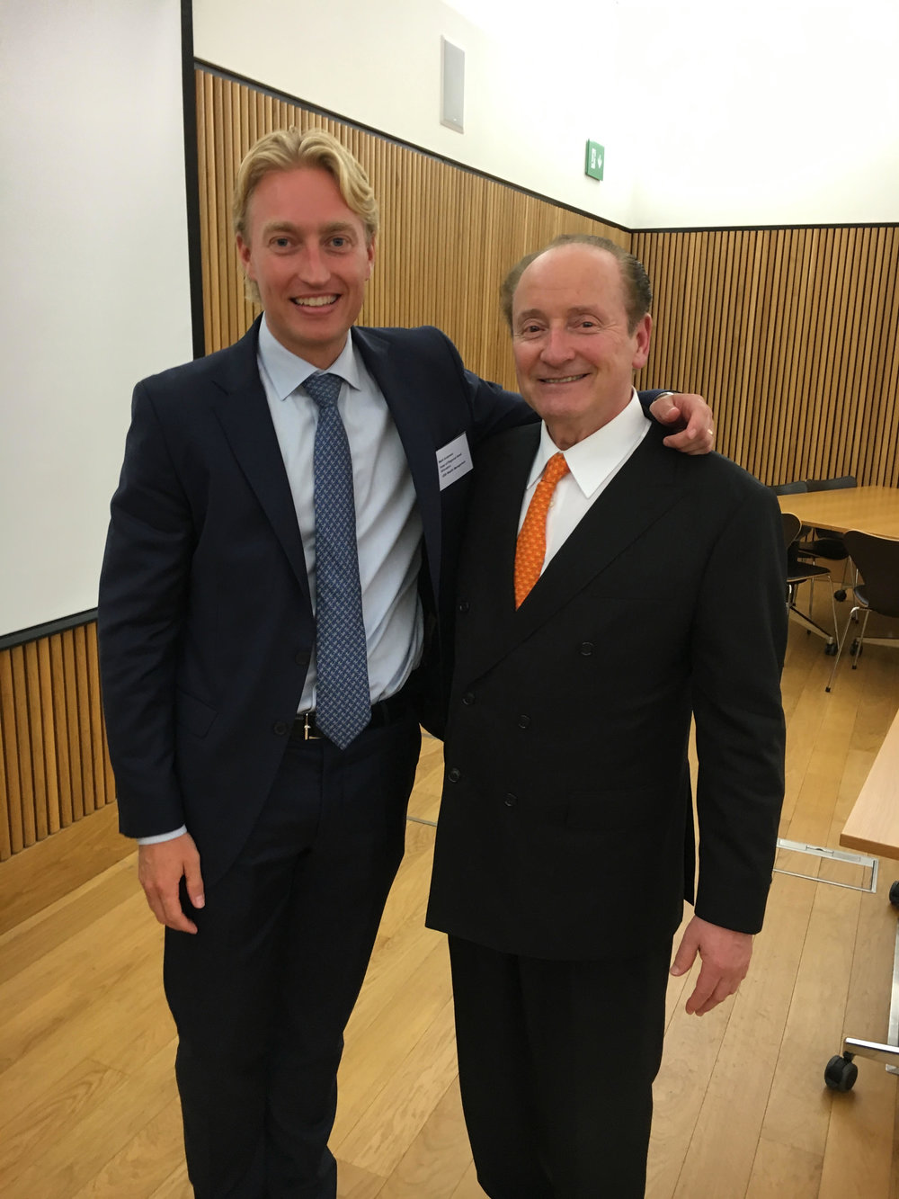 "Mark with Robert C. Merton at a conference on retirement investing in Oxford. Robert won a Nobel Prize for improving the Black-Scholes formula, and has a passion for financial institutions to have ""more meaningful dialogues"" with their clients and bring people solutions instead of products."