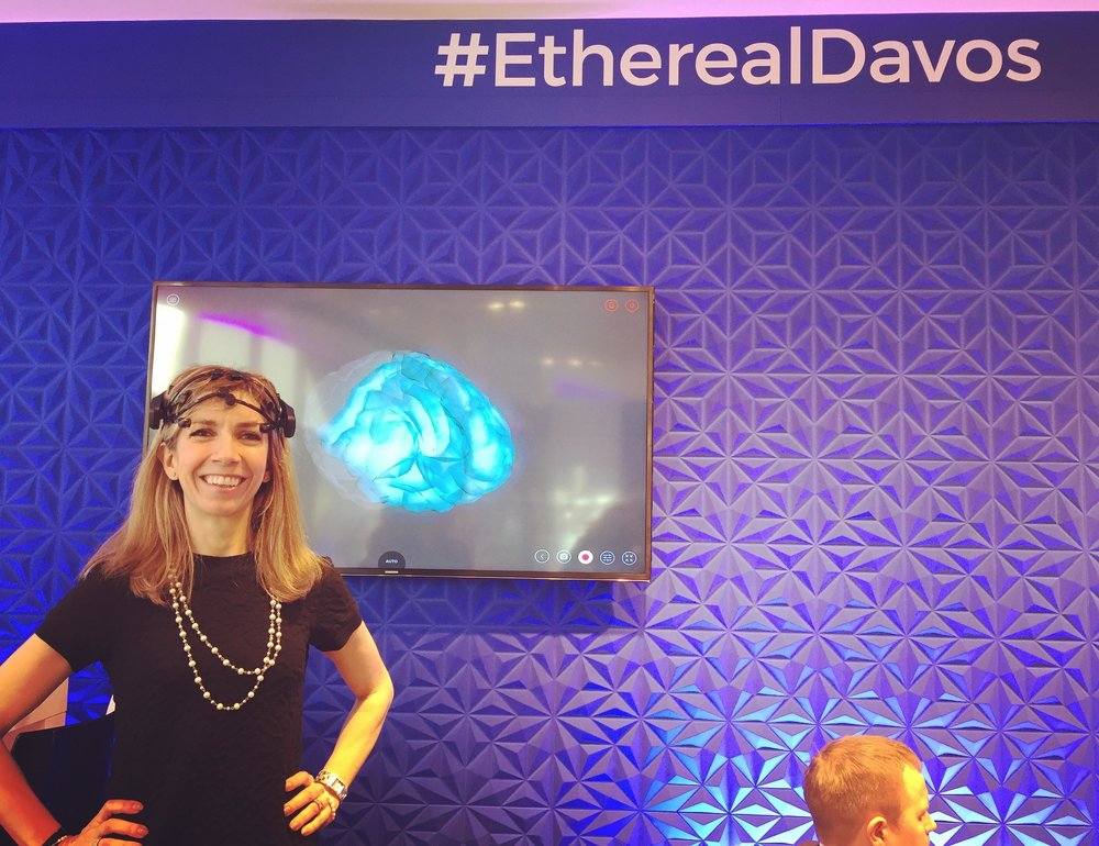 "Manuela Andaloro testing the ""DavosBrains"" headset. Davos, January 2018"