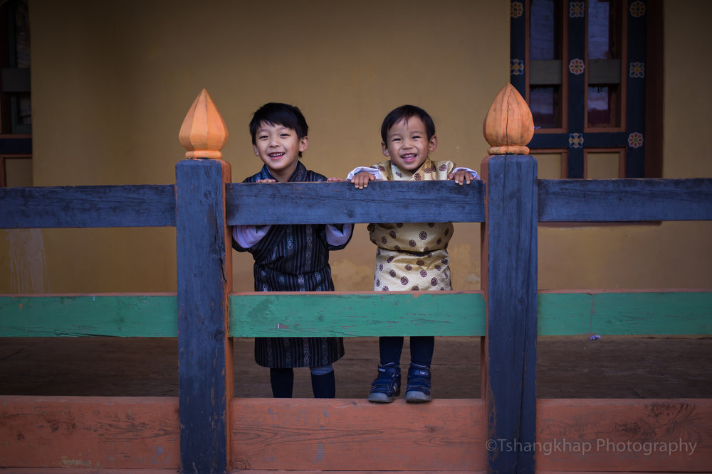 My boys wearing national dress and exploring Semtokha dzong