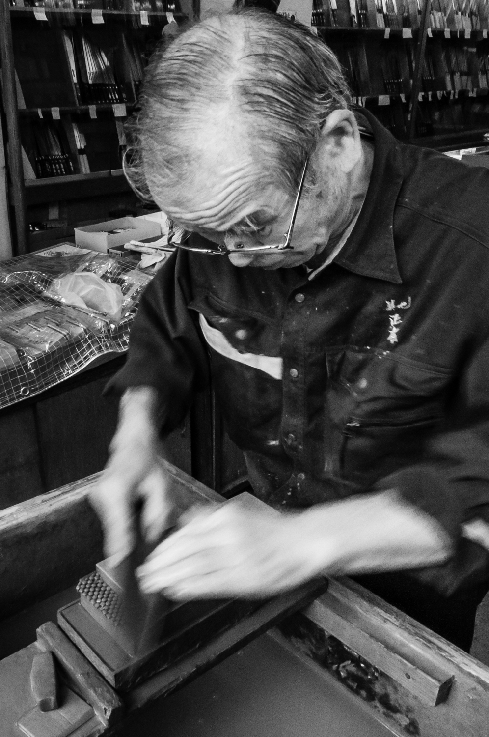 An artisans sharpens the cutlery the old way, before it gets sold to the customers.