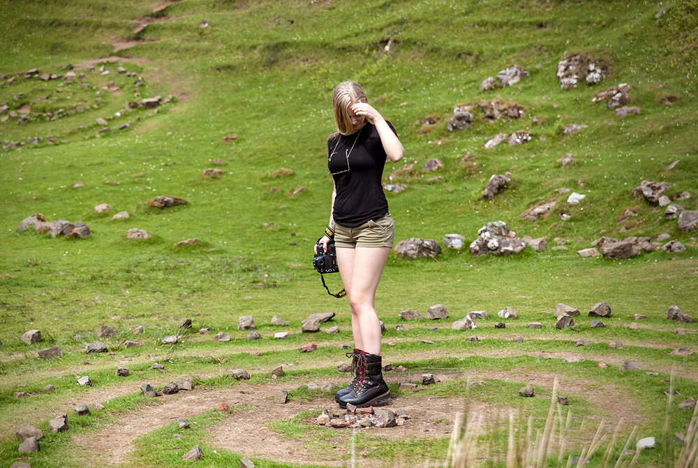 Inga trying to figure out the stone circles in the Fairy Glen. Photo by Siv