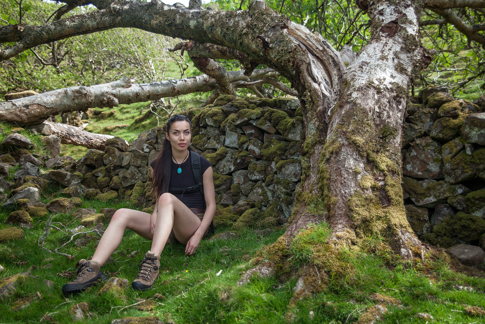 Siv enjoying some shade in the Fairy Glen, Uig. Photo by Inga