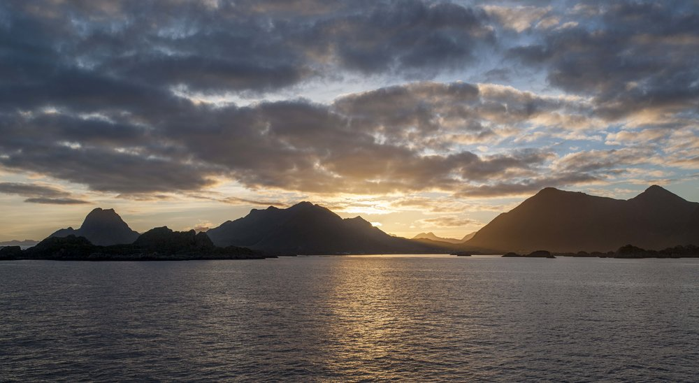 Hurtigruten arrives in Lofoten just before the sun goes down