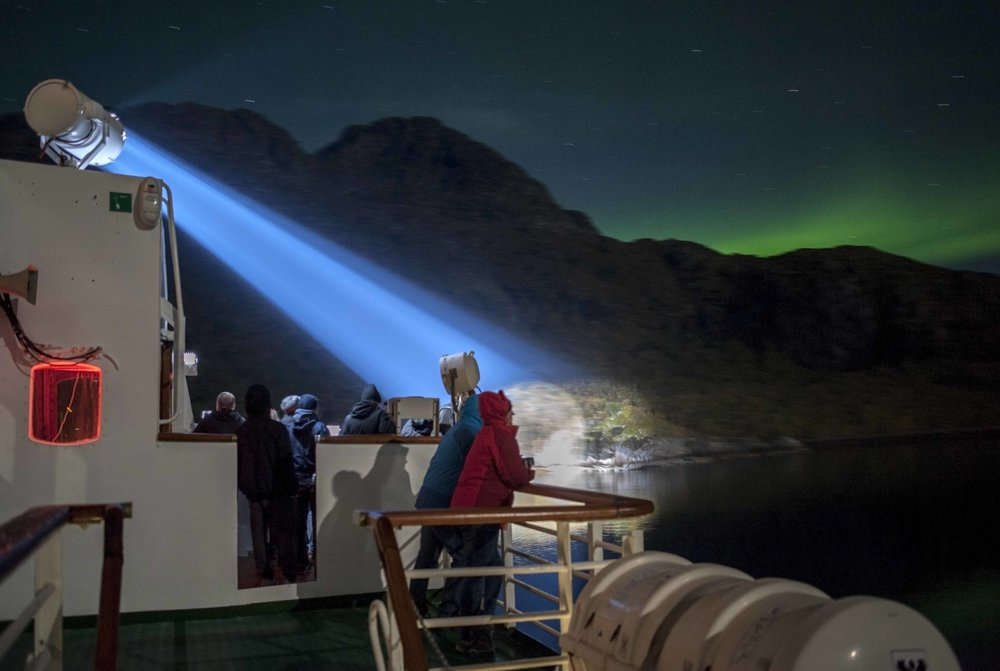 Doing long exposures on a ship was a first for me. Noisy and technically shit, yet very touristy picture of Trollfjorden and a bit of northern lights in the horizon.