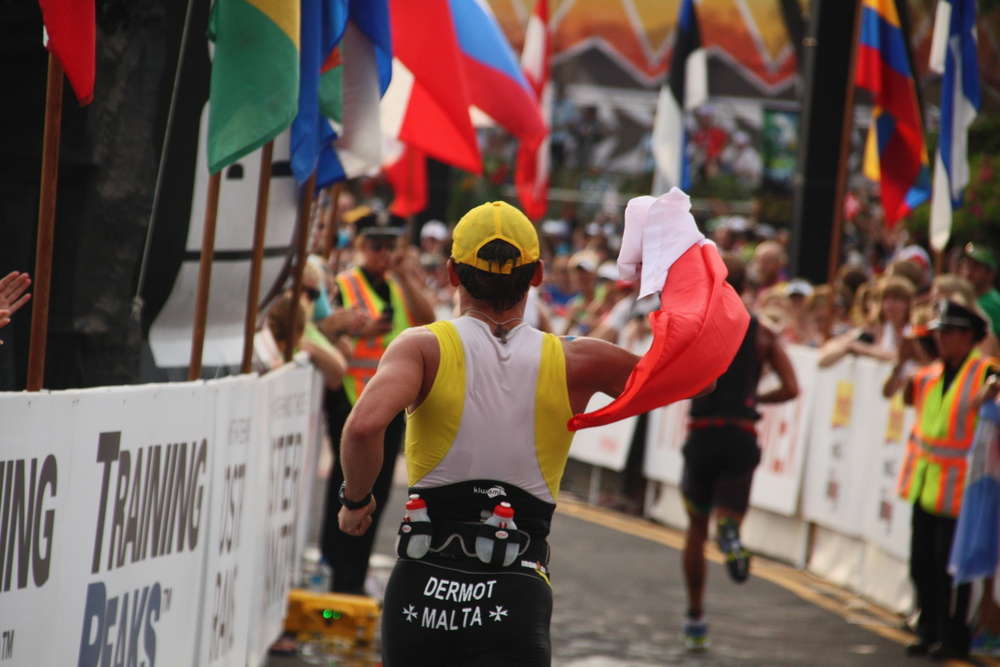 Dermot approaching the finish line at the IRONMAN World Championships in 2013