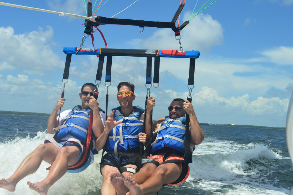 Up, up and away with our friend Darren, parasailing in Destin, Florida in