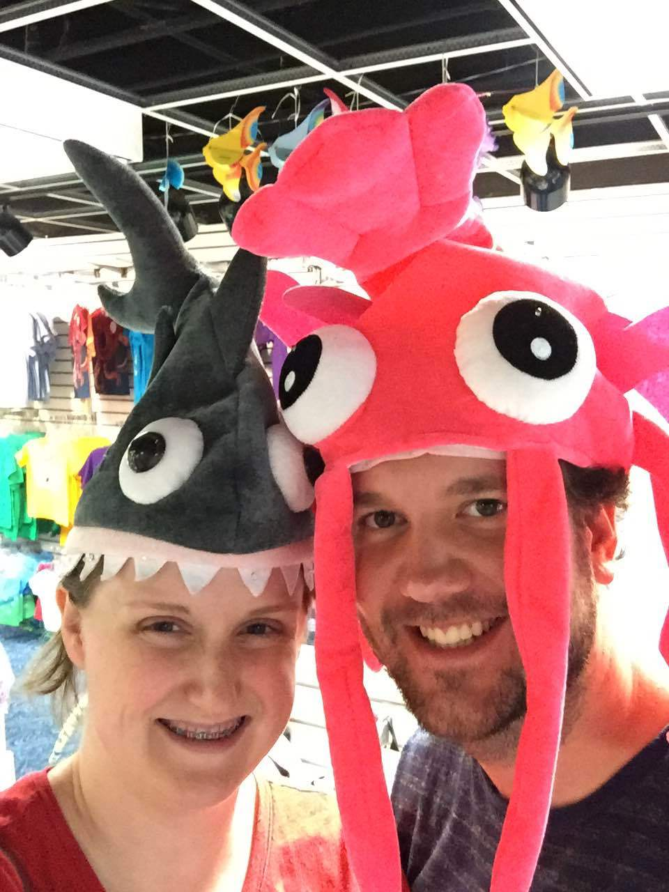 Trying on silly fish hats at Moody Gardens.