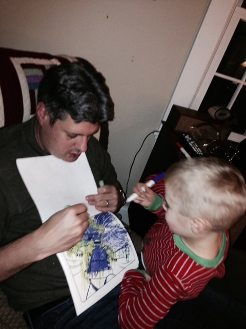 Andre coloring with nephew.JPG