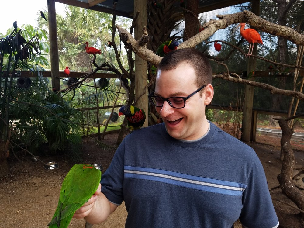 Steve feeding birds in Florida.jpg