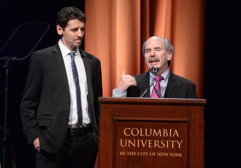 "Danny Zwerdling (left) and Michael de Yoanna accept the duPont-Columbia Award for their reporting, ""Invisible Wounds."""