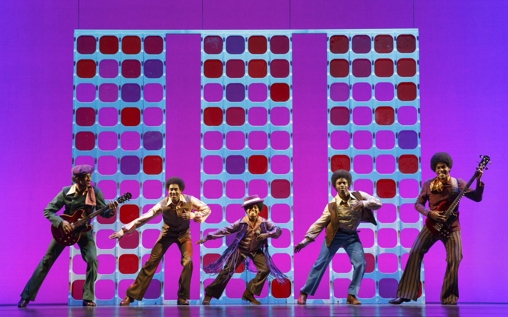 Reed L Shannon as Michael Jackson (center) with the Jackson 5. MOTOWN THE MUSICAL First National Tour. (c) Joan Marcus, 2014.jpg